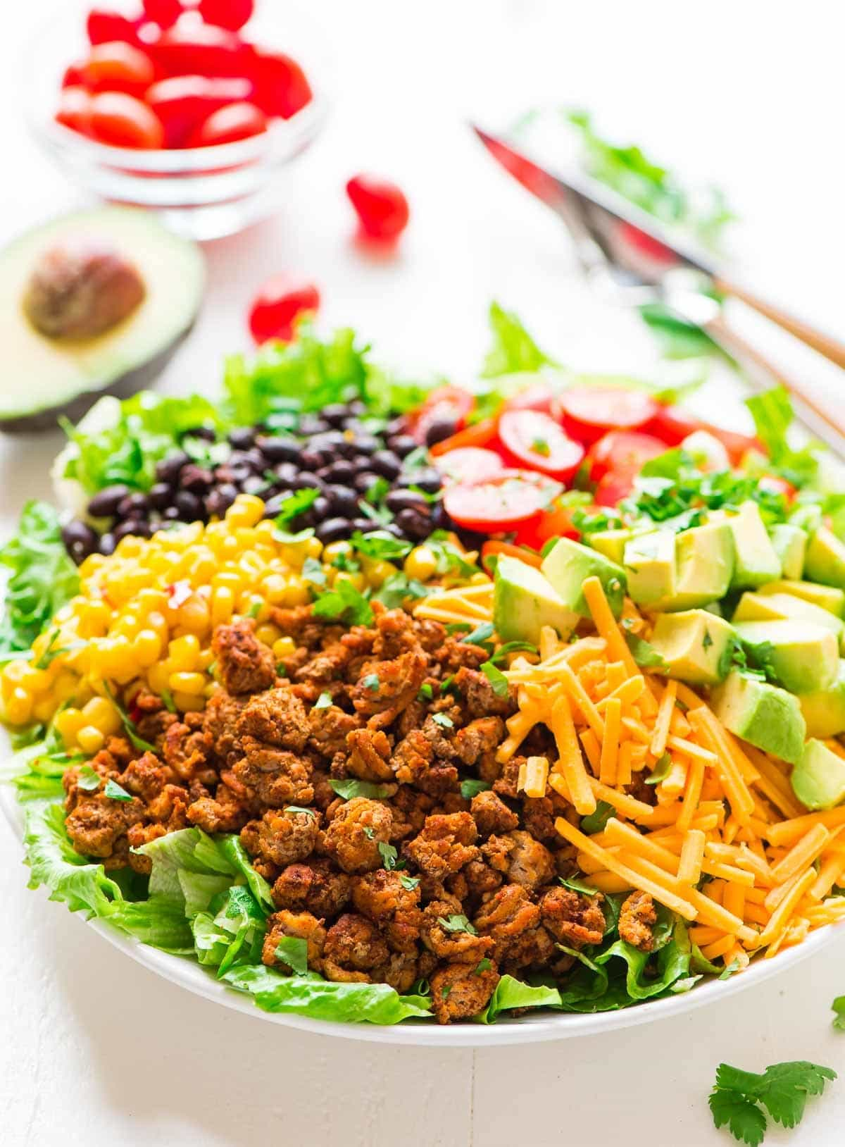 Easy ground turkey salad with tons of taco flavors like corn, black beans, and avocado