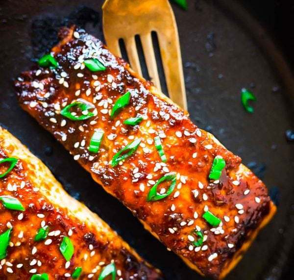 A skillet with seared salmon