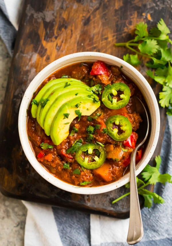 Sweet potato chili served in a bowl with jalapenos and avocado slices