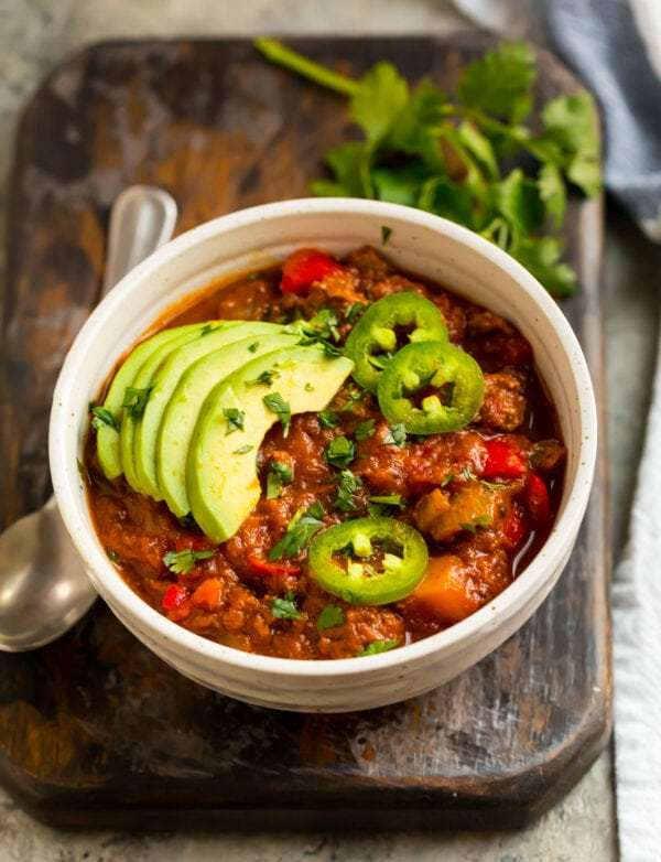 The best Whole30 chili recipe in a bowl with avocado and jalapeno