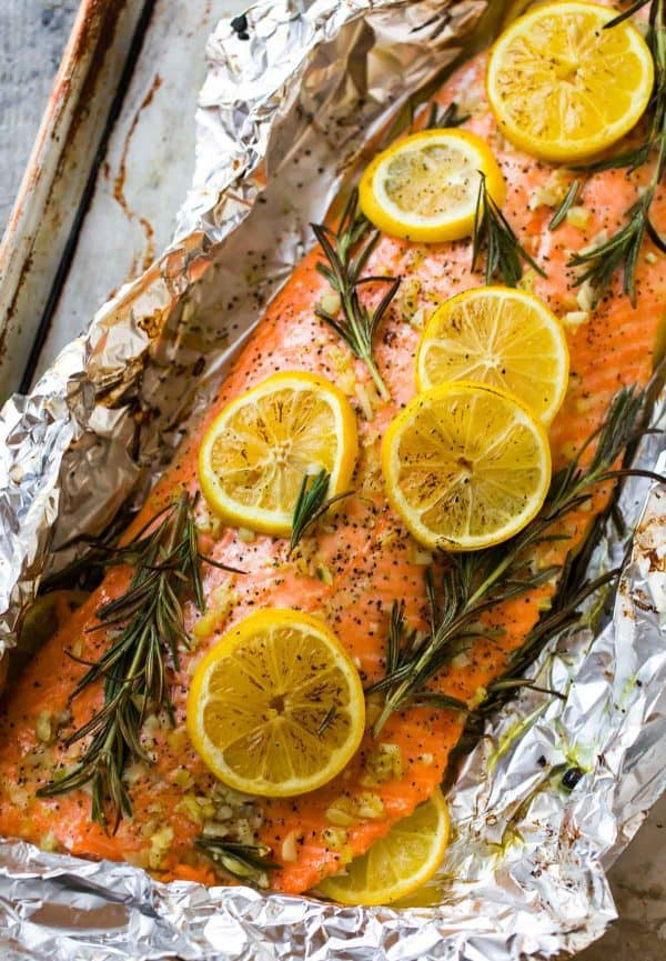 Healthy baked salmon in foil with lemon and dill and instructions for how long to bake it at 375 degrees F