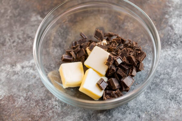 A bowl with butter and chopped chocolate for making muffins