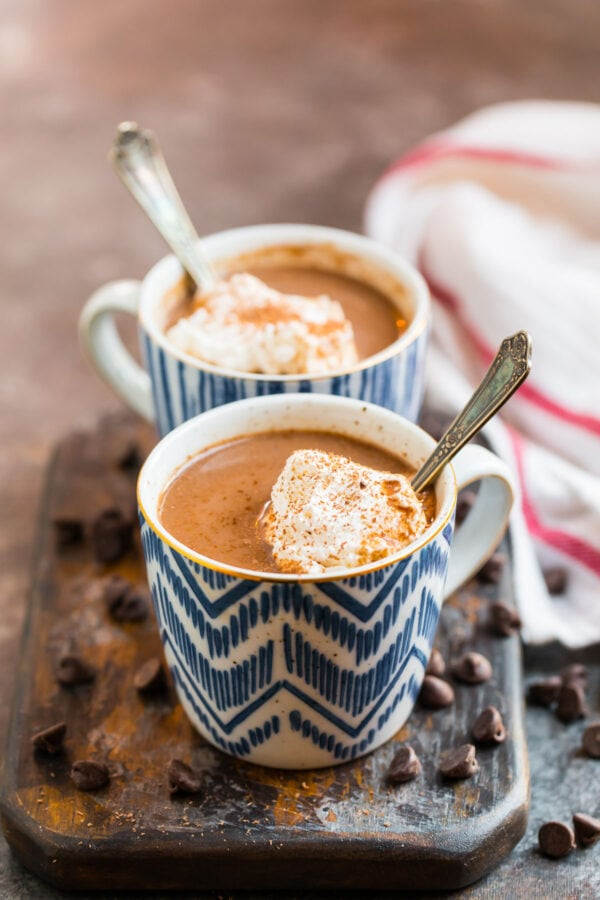 Healthy hot chocolate recipe served in mugs with whipped cream