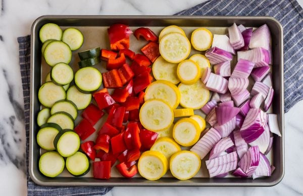 Zucchini, red bell pepper, summer squash, and red onion prepped for Grilled Chicken Kabobs