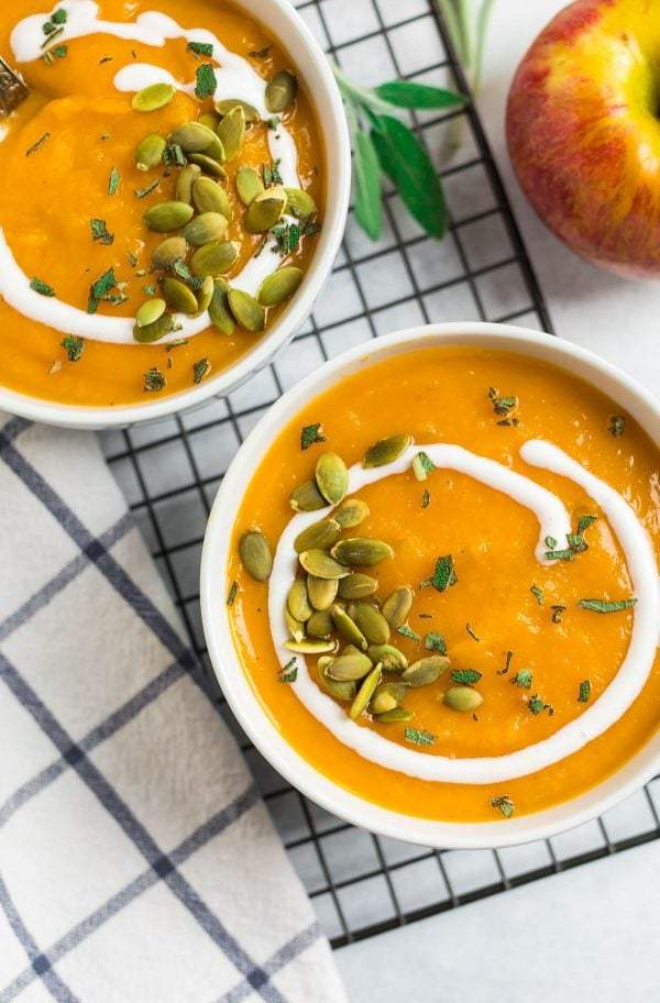 Easy crockpot butternut squash soup recipe made vegan with coconut milk served in bowls