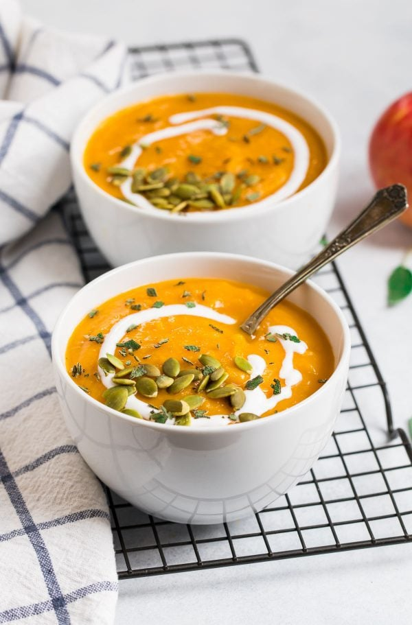 The best crockpot butternut squash soup made vegan with coconut milk and served in bowls