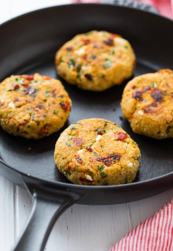 Mediterranean Quinoa burgers are packed with flavor from sun-dried tomatoes, herbs, and feta cheese.