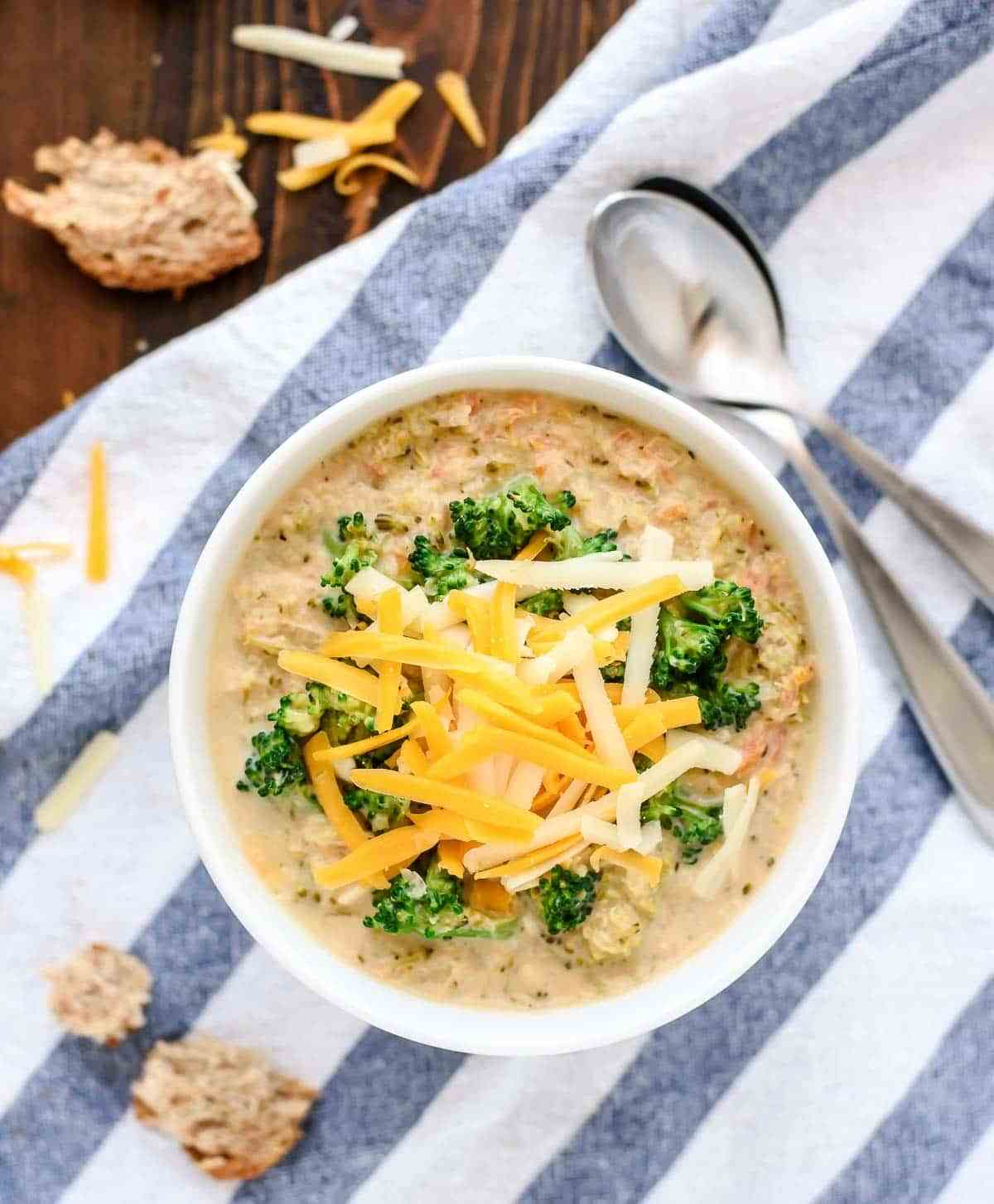 The BEST and EASIEST Slow Cooker Broccoli and Cheese Soup that's even better than Panera's! Made with lots of fresh veggies and cheddar, and it's always a crowd favorite!