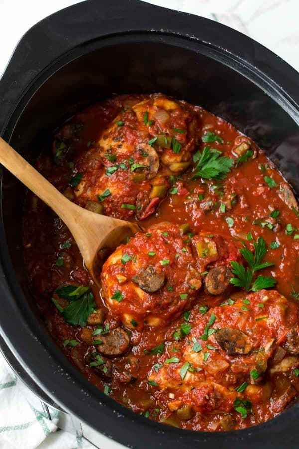 Easy Slow Cooker Chicken Cacciatore. A tasty slow cooker dinner made with boneless, skinless chicken breasts, crushed tomatoes, mushrooms, and bell peppers.
