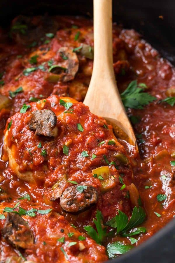 Healthy Slow Cooker Chicken Cacciatore is packed with flavor, including crushed tomatoes, garlic, and Italian spices.