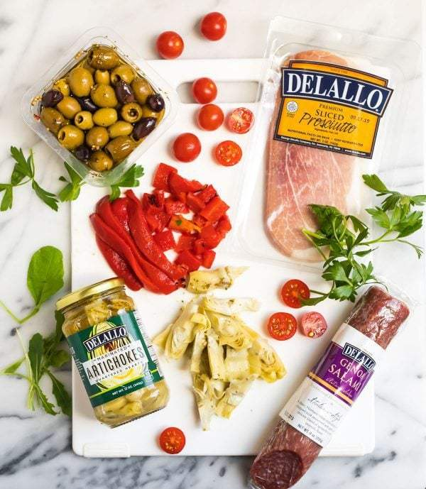 Ingredients for Italian Antipasto Salad on a cutting board
