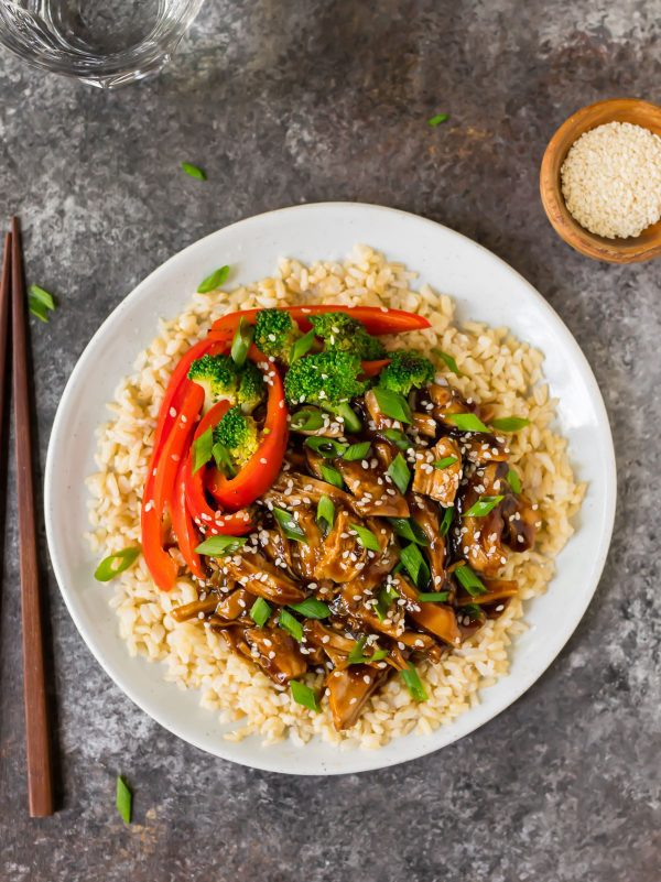 A plate of brown rice, Instant Pot Teriyaki Chicken, and veggies