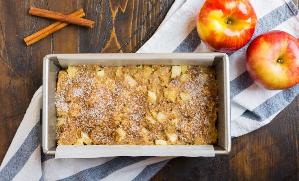 Cinnamon sugar topping on apple bread recipe made with applesauce and apples