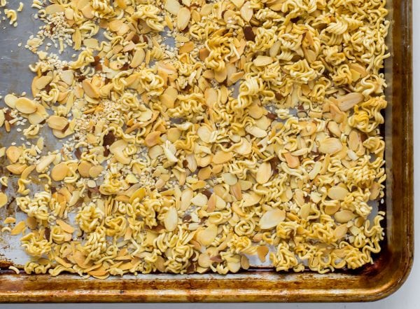 A sheet pan of toasted ramen noodles and almonds