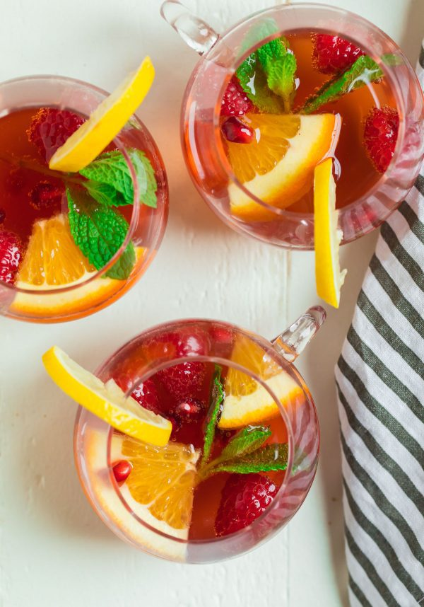 Champagne Punch for a crowd. Filled with citrus, raspberry, and champagne.