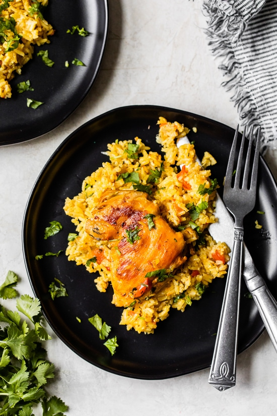 Authentic Arroz Con Pollo, or Latin chicken and rice, is the ultimate one-pan meal. It's a classic Colombian dish that I grew up on that I now love to cook for my family.