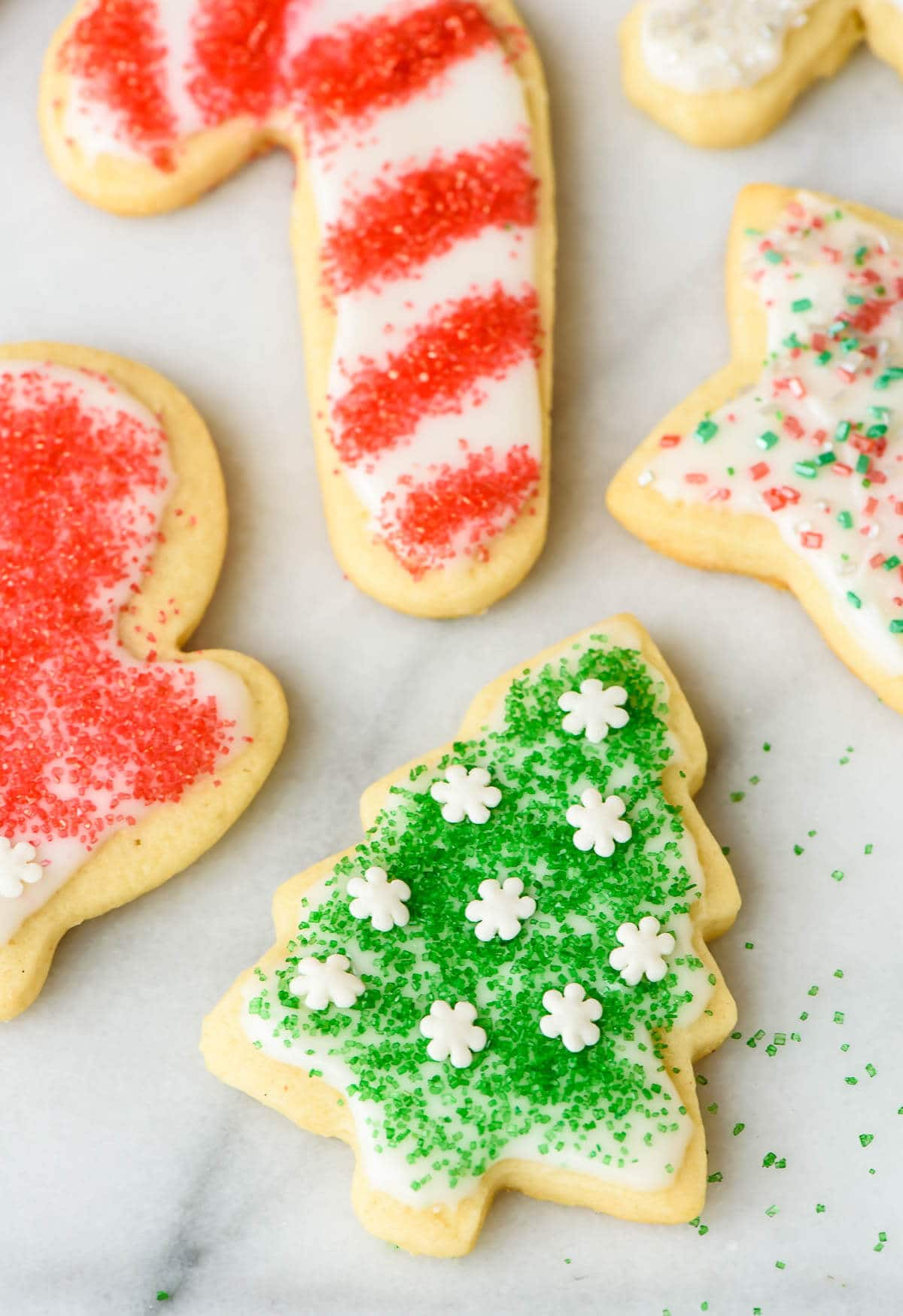 How to make cut out sugar cookies, step by step. This cream cheese sugar cookie recipe is so easy and foolproof! Even kids can make these.