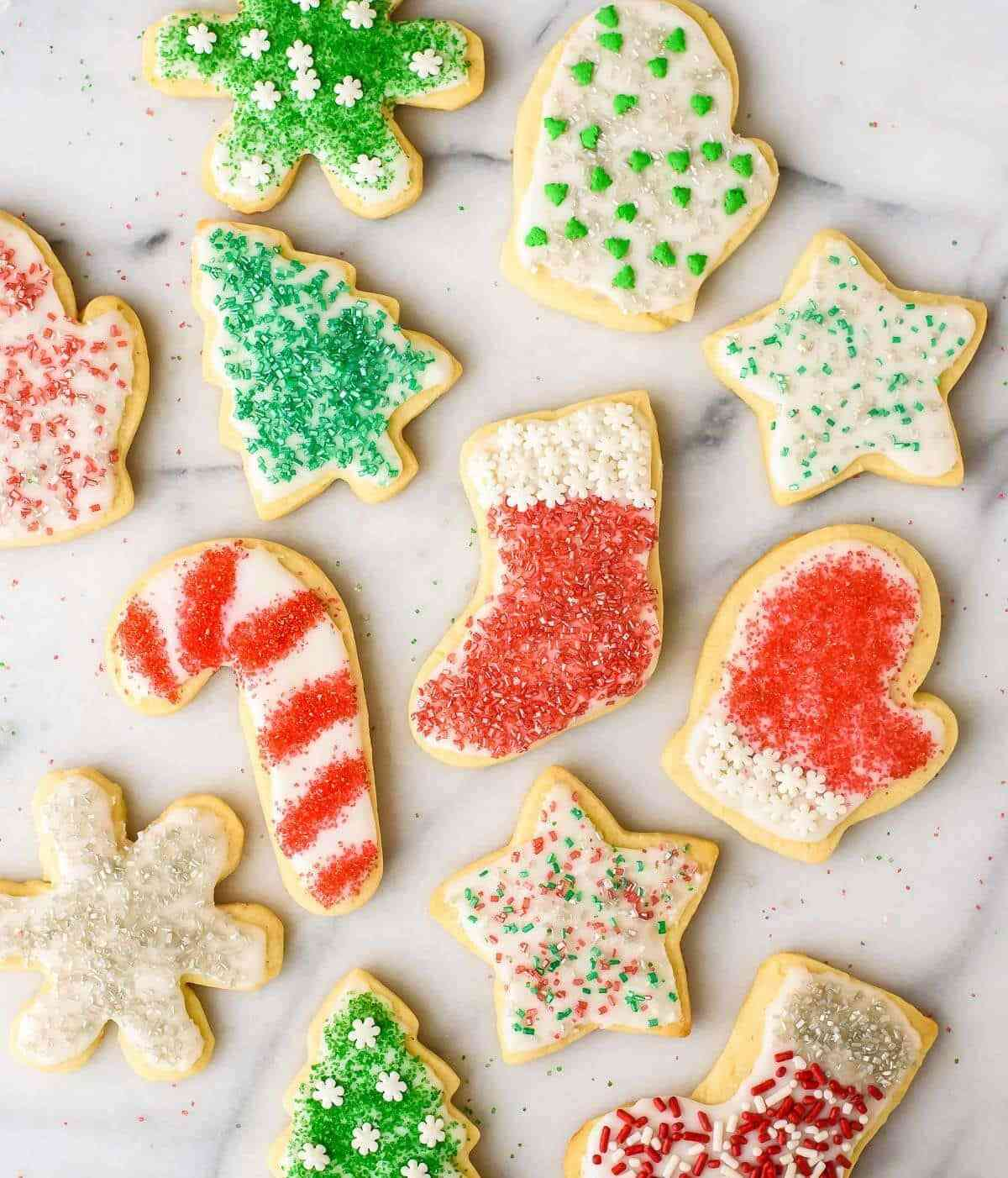 Soft and fluffy Cream Cheese Sugar Cookies with Perfect Icing. The only cut out cookie recipe you will ever need!