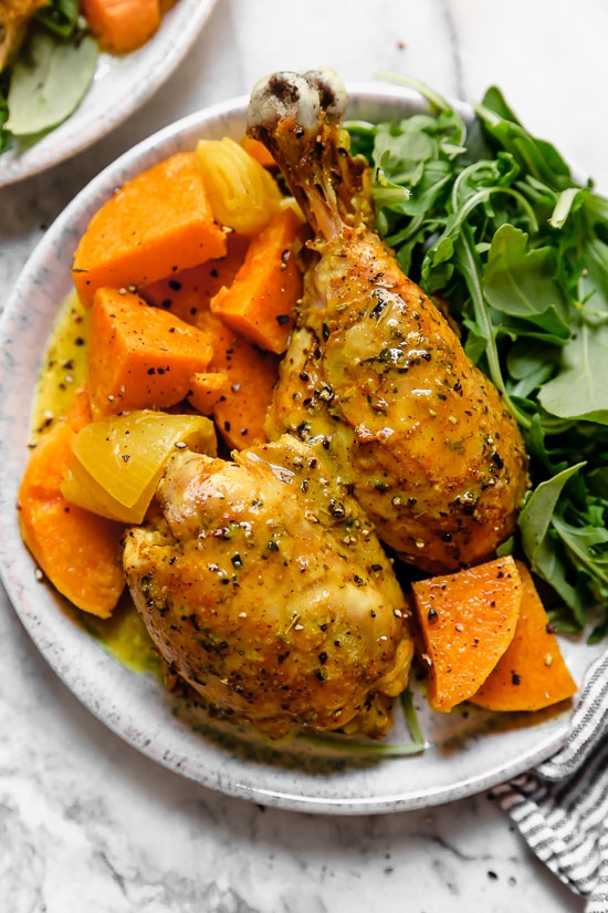 Caramelized sweet potatoes and shallots are the bed for roasted chicken thighs and legs that come together in this one-pot healthy chicken dinner.