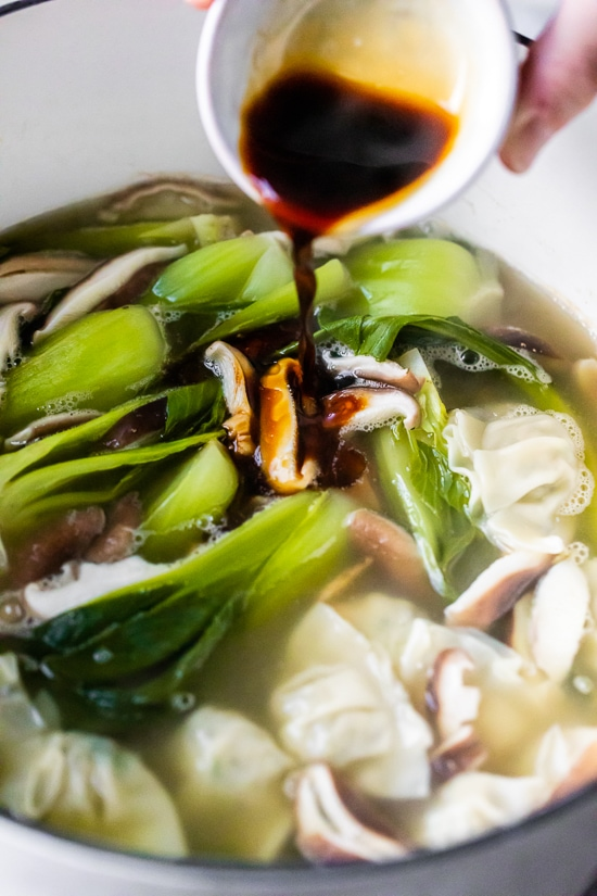 Loaded with vegetables, this quick and easy wonton soup is super simple, and takes under 15 minutes to make thanks to the frozen wontons.