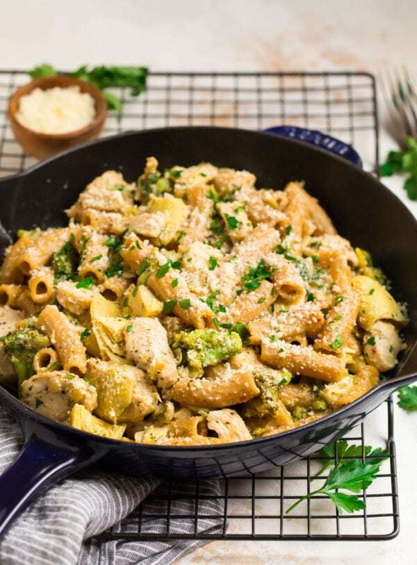 A skillet with chicken, pasta, and vegetables