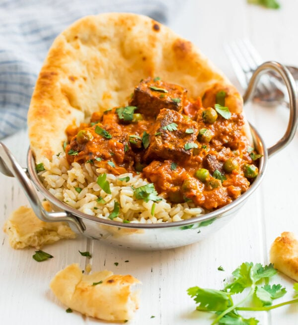 An easy and healthy vegetarian Indian recipe in a bowl with brown rice and naan bread