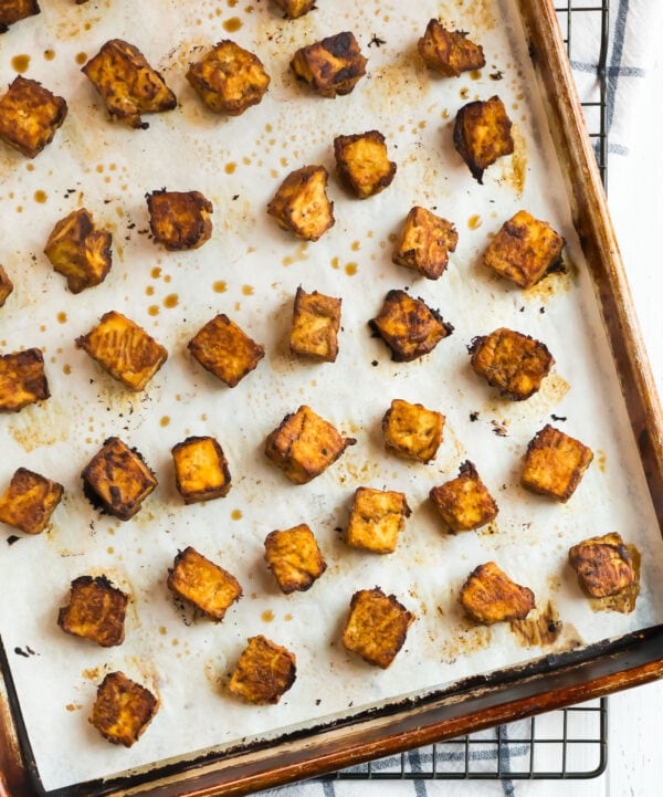Pieces of crispy and firm tofu on a baking sheet