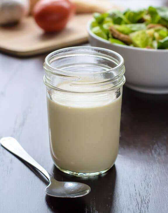 Healthy homemade Caesar salad dressing in a jar