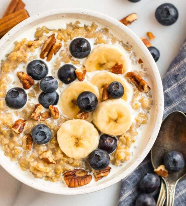 Instant Pot steel cut oats with banana, blueberries, and pecans