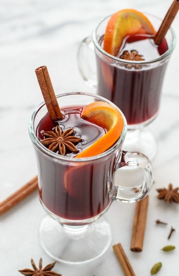 Traditional mulled wine crockpot recipe served in glasses with cinnamon