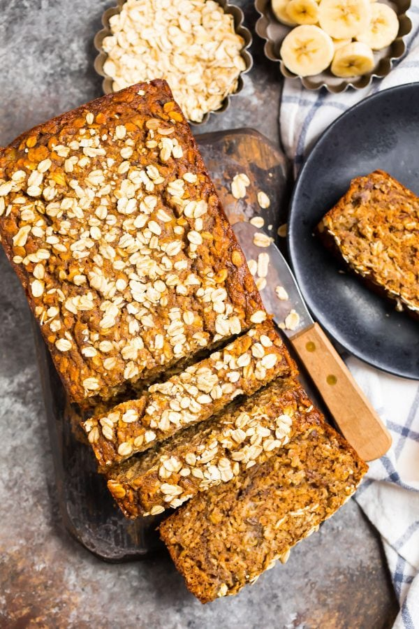 Healthy Oatmeal Banana Bread with ripe bananas and oats, cut into slices with maple syrup
