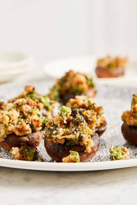 I'm OBSESSED with these Italian stuffed mushrooms filled with broccoli rabe and sausage, the perfect festive holiday appetizer!