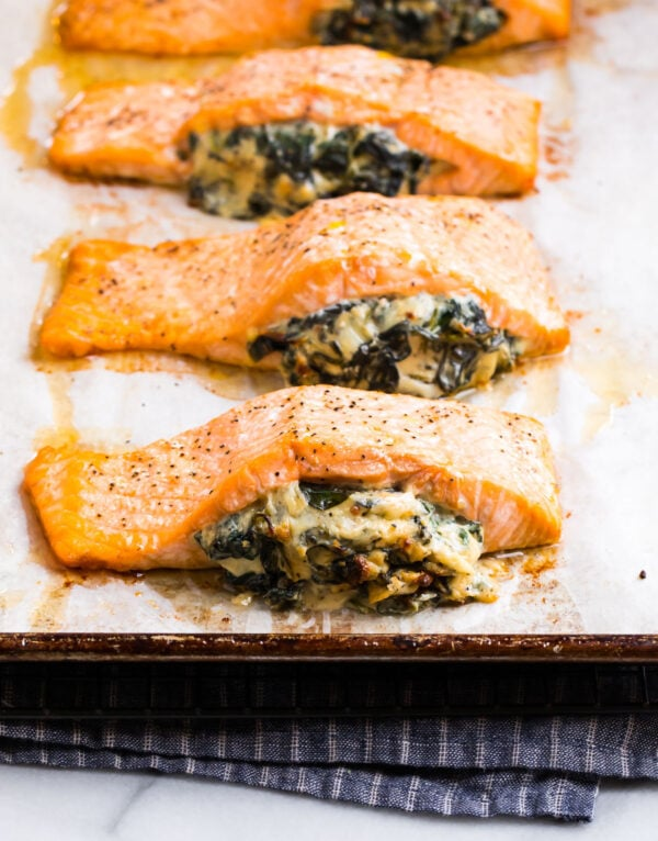 Stuffed salmon with spinach and cream cheese on a baking sheet