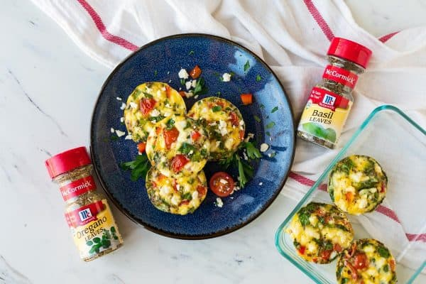 A plate with eggs, veggies, and cheese for a healthy breakfast