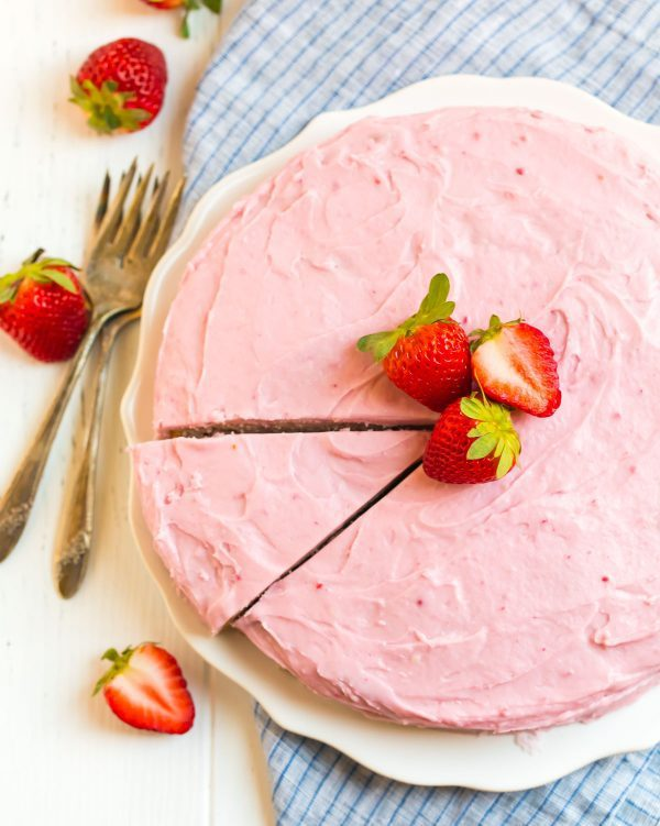 Fresh strawberry cake recipe from scratch served on a plate with fresh strawberries