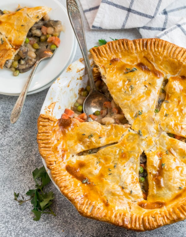 A tasty vegetarian pot pie with a slice cut out
