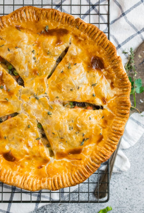 Easy vegetarian pot pie in a pie with with a golden, flaky crust
