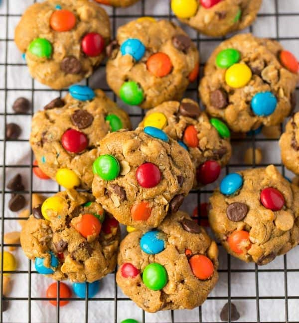 Soft, chewy monster cookies on a wire rack