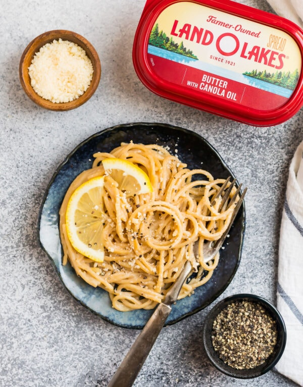 Easy pasta al limone on a plate with butter, cheese, and pepper