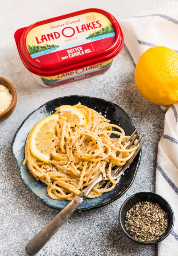 A plate of noodles with lemon, cheese, butter, and pepper