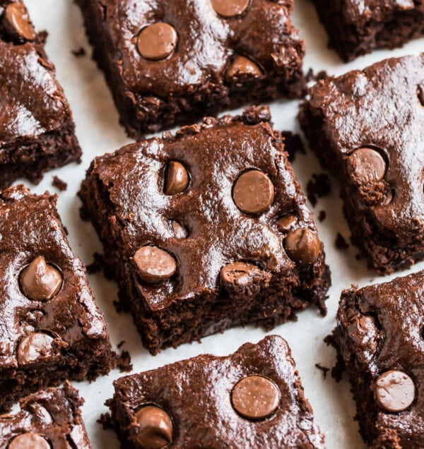 A close photo of moist, fudgy vegan brownies with chocolate chips