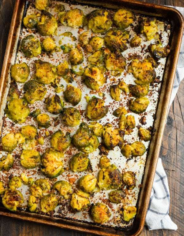 Parmesan smashed Brussels sprouts on a baking sheet