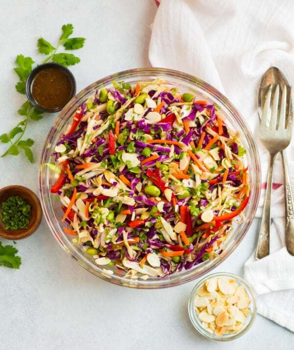Asian cabbage salad with almonds in a large mixing bowl