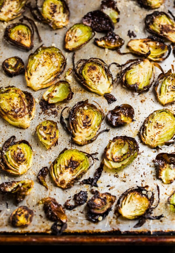 Crispy baked Brussels sprouts chips on a sheet pan