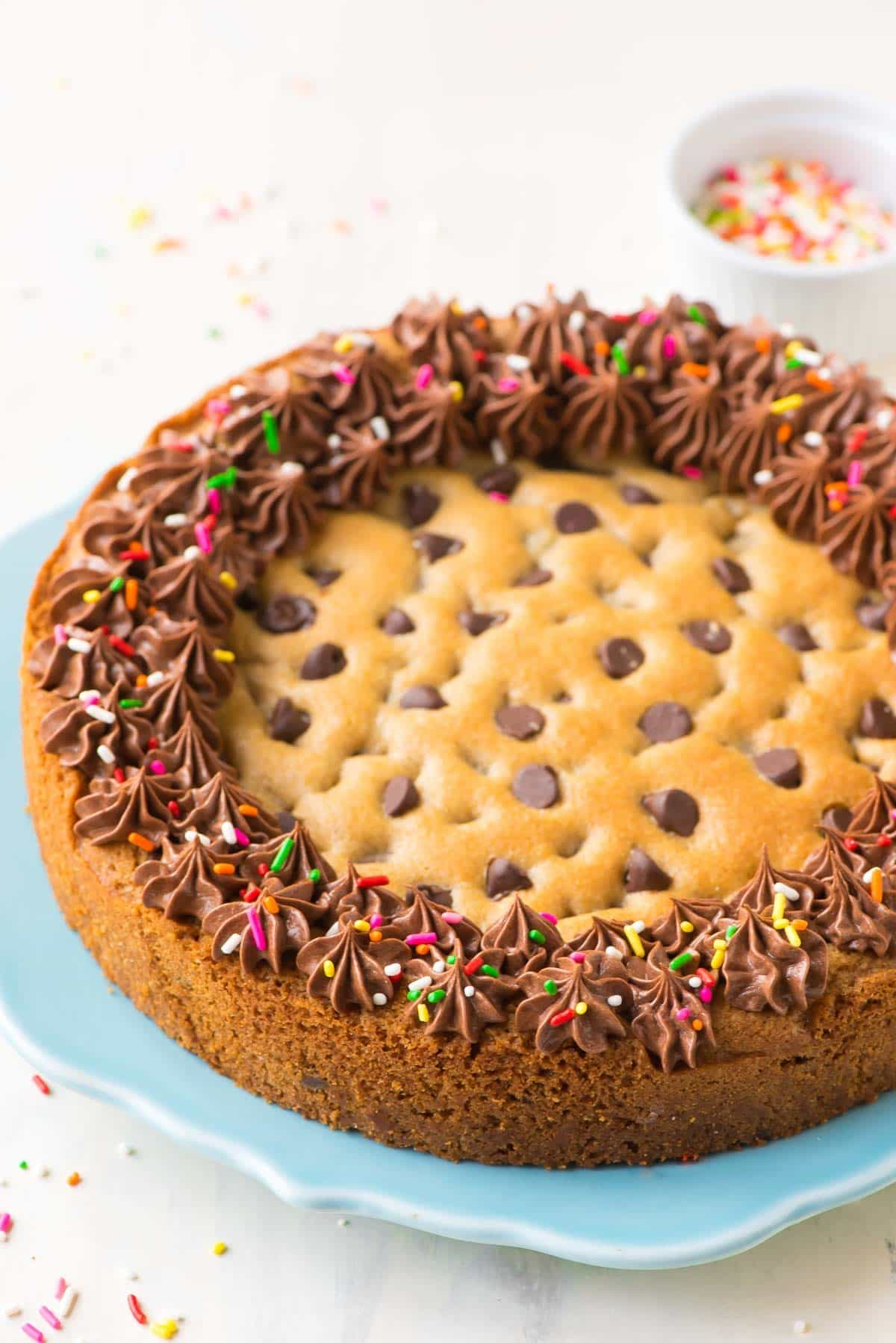 A giant cookie cake recipe with frosting and sprinkles