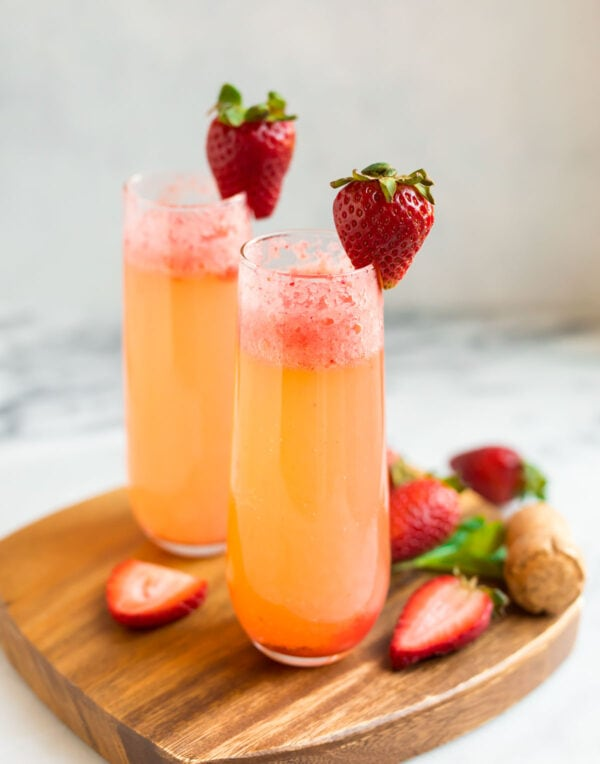 Two glasses with strawberry champagne drink