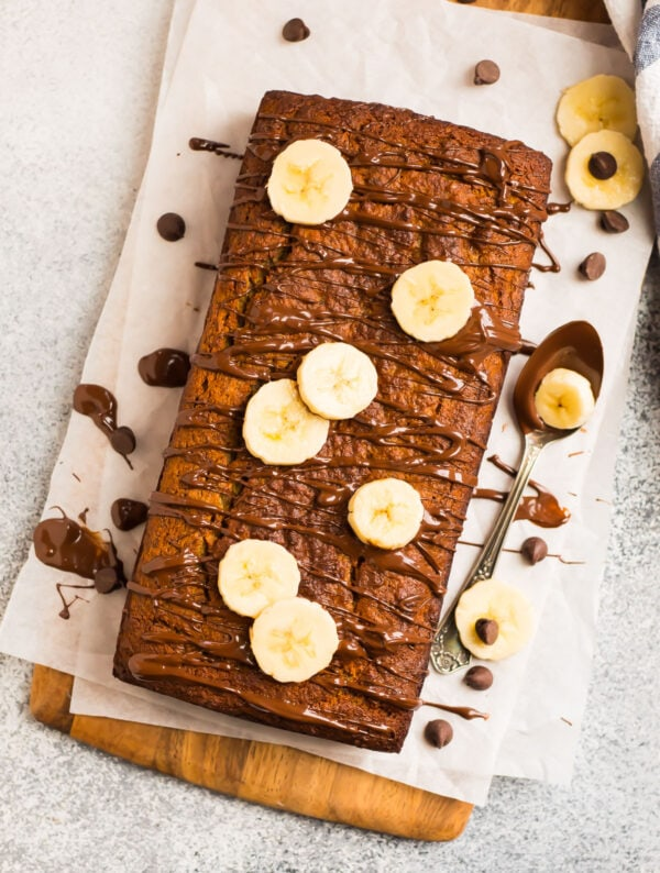 Banana bread made with almond flour topped with chocolate and banana slices