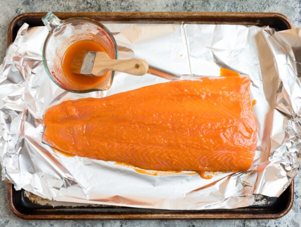 a fillet of salmon brushed with honey buffalo sauce
