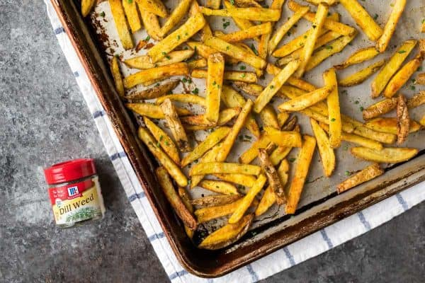 A baking sheet with healthy seasoned French fries