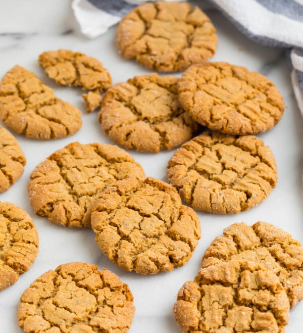 A white backboard with vegan peanut butter cookies